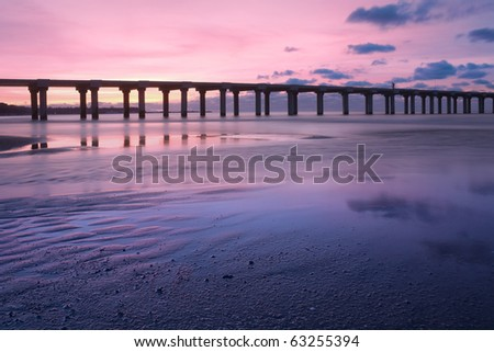 Pier on the beach - stock photo