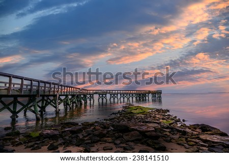 Pier on the Chesapeake Bay at sunset - stock photo