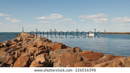 pier or jetty on a blue ocean and cloudy sky reflection on water. Long exposure, Montauk, Long Island, USA. - stock photo