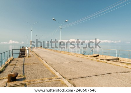 Pier stretching out to the sea - stock photo
