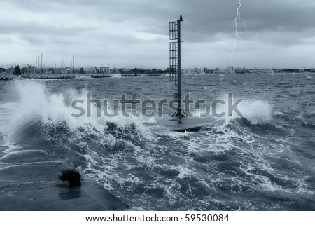 pier submerged by waves during the storm - stock photo