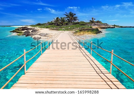 Pier to the tropical island of Caribbean Sea - stock photo