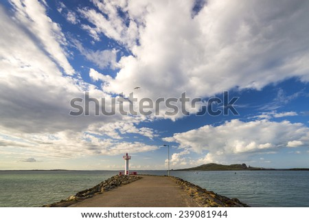 Pier with lighthouse sea view. Ireland, Howth. Small fishing town - stock photo