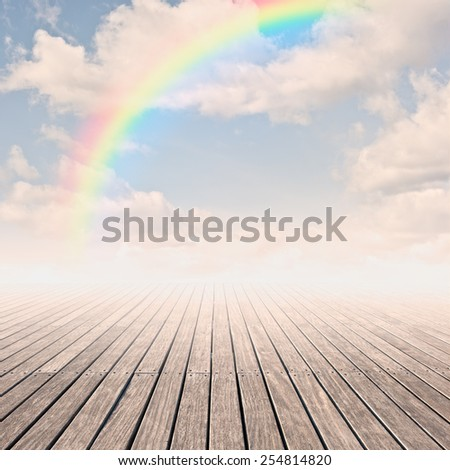 pier with rainbow on sunset - stock photo