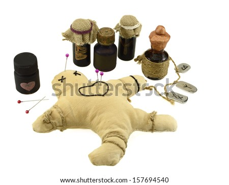 Pierced voodoo doll with love potion bottles isolated on white - stock photo