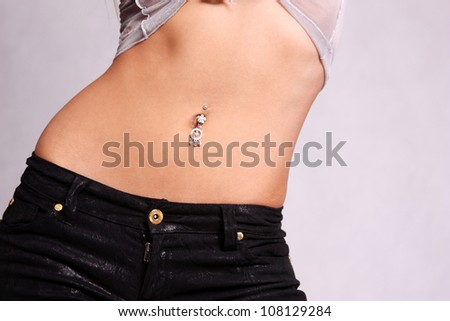 piercing in the navel - stock photo