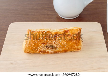 Pies of puff pastry on tray wood - stock photo