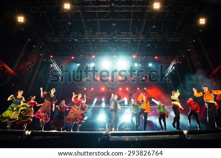 PIESTANY, SLOVAKIA - JUNE 28: Slovak music group IMT Smile featuring Slovak National Folklore Ballet Lucnica performs on music festival Topfest in Piestany, Slovakia on June 28, 2015