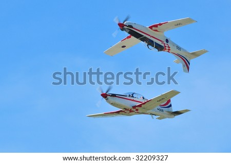 PIESTANY, SLOVAKIA - JUNE 14: Two airplanes of Krila Oluje - Croatian Air Force aerobatic display team at very close distance on the Piestany airshow, Slovakia, June 14, 2009