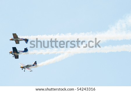 PIESTANY, SLOVAKIA - MAY 29: The flying bulls aerobatics team performs extremely difficult flight maneuver - mirror flight on the airshow in Piestany, Slovakia, May 29, 2010