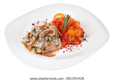 Pig Ears with spices and paprika on white plate, isolated on white background. - stock photo