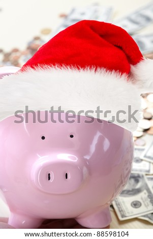 Pig in a red cap near paper money