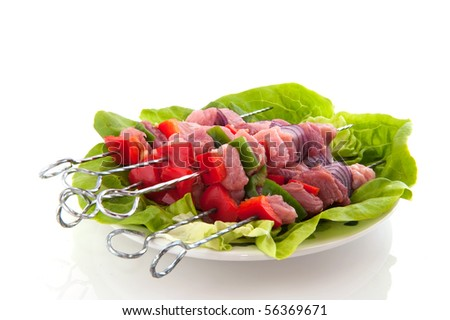 Pig meat pins with vegetables for roasting on the barbecue