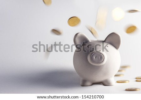 pig money box with golden coins - stock photo