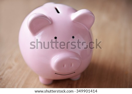 Pig moneybox on wooden background