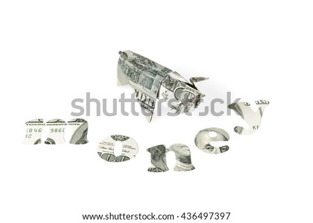 Pig origami made from hundred dollar bills and the word money cut from dollars isolated on white background