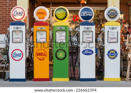 PIGEON FORGE, TENNESSEE - OCTOBER 21: Five vintage gas pumps outside of a store on October 21, 2014 in Pigeon Forge, Tennessee - stock photo