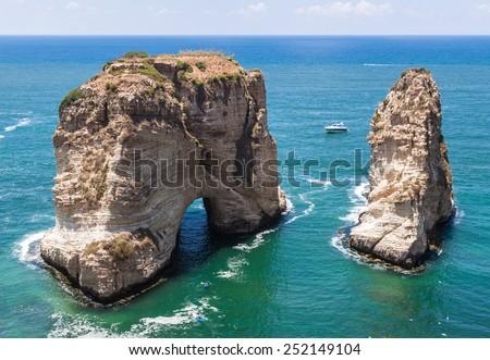 Pigeons' Rock limestone island in Beirut, Lebanon. City landscape of Beirut - capital of Lebanon. Beirut landmarks and famous places. - stock photo