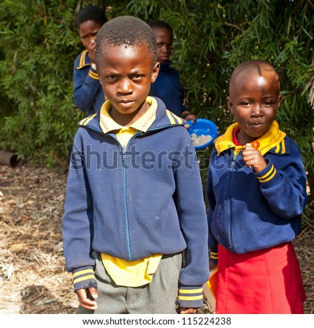 PIGGS PEAK, SWAZILAND-JULY 29: Unidentified orphan children on July 29, 2008 in Nazarene Mission School, Piggs Peak, Swaziland. Close to 10% of Swaziland'Â?Â?s population are orphans, due to HIV/AIDS. - stock photo