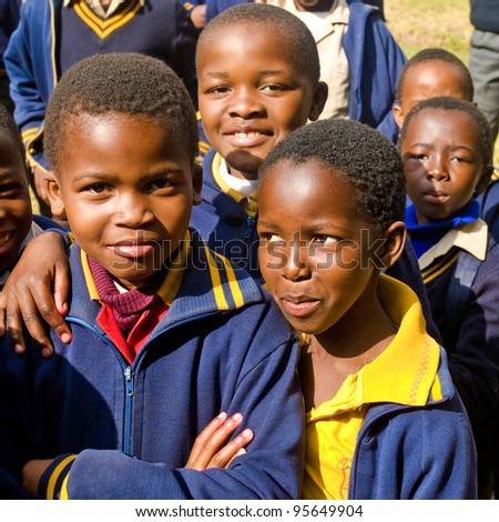 PIGGS PEAK, SWAZILAND-JULY 29: Unidentified Swazi pupils on July 29, 2008 in Nazarene Mission School, Piggs Peak, Swaziland. Close to 10% of Swaziland population are orphans, due to HIV/AIDS. - stock photo