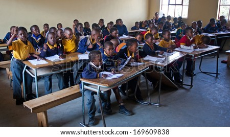 PIGGS PEAK, SWAZILAND-JULY 29: Unidentified Swazi schoolboys on July 29, 2008 in Nazarene Mission School, Piggs Peak, Swaziland. Close to 10% of Swaziland�s population are orphans, due to HIV/AIDS. - stock photo
