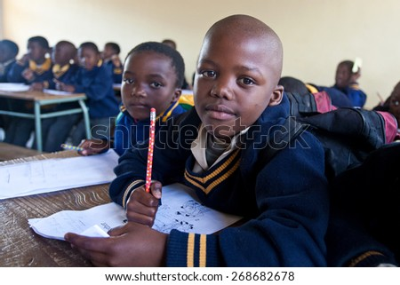 PIGGS PEAK, SWAZILAND-JULY 29: Unidentified Swazi schoolboys on July 29, 2008 in Nazarene Mission School, Piggs Peak, Swaziland. Close to 10% of the Swazi population are orphans, due to HIV/AIDS. - stock photo
