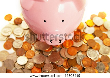 piggy bank and assorted coins, from above - stock photo