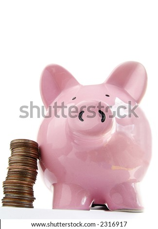 Piggy bank and coins on white - stock photo