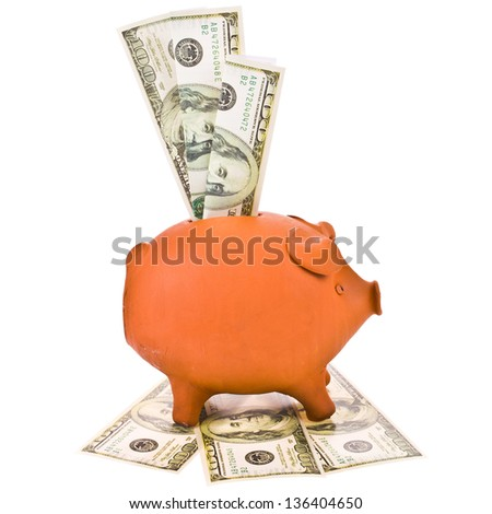 piggy bank  and folded paper dollars isolated on white background - stock photo