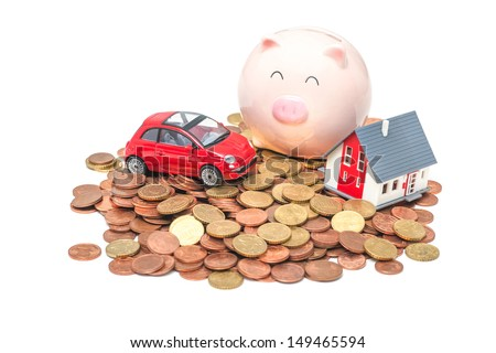 Piggy bank and house on the white background - stock photo