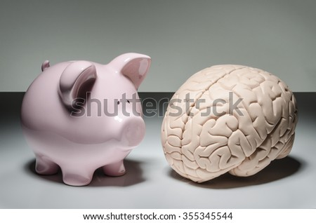 Piggy bank and human brain - stock photo