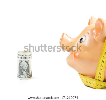 piggy bank and measure tape near dollars on white background with space for text, concept for business and save money - stock photo