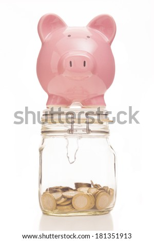 Piggy bank and money jar on white background