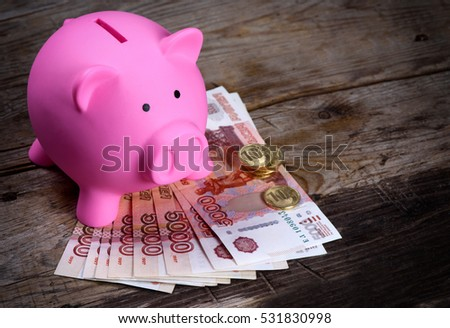 Piggy bank and Russian money. Financial concept