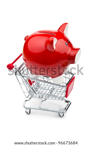 Piggy bank and shopping cart on white - stock photo