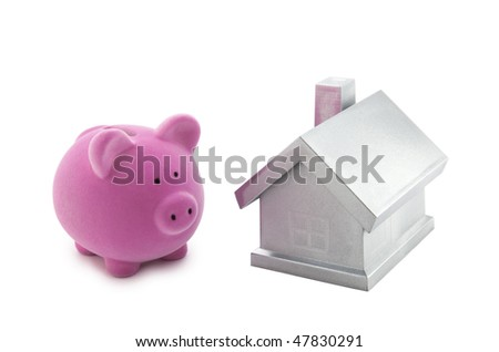 Piggy bank and silver house with clipping path