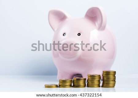 Piggy bank and stacked coins.