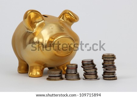 piggy bank and stacks of coins