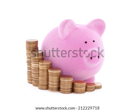 Piggy bank and stacks of coins with clipping path - stock photo