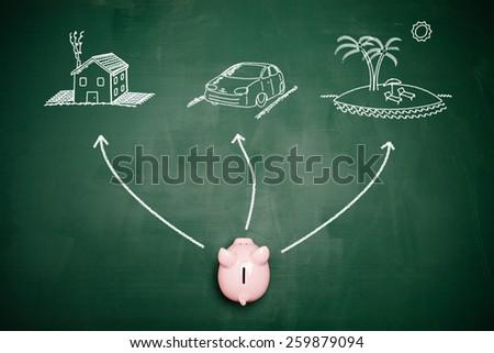 Piggy bank choosing his financial goals - stock photo