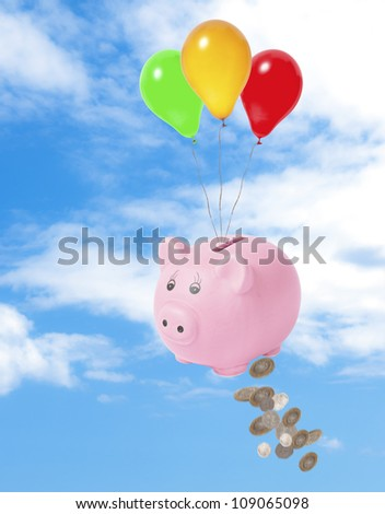 Piggy bank floating in sky losing money - financial crisis concept - stock photo