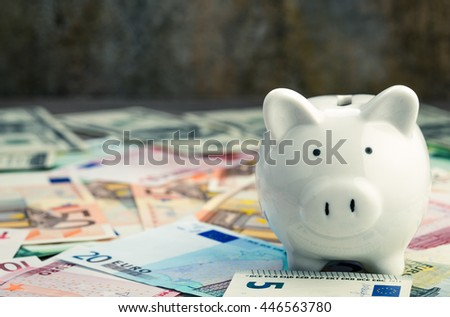 Piggy bank from right side of various banknotes background - stock photo