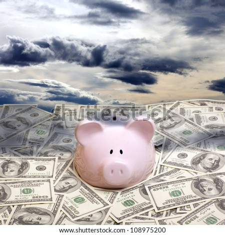 Piggy bank in a pile of dollars. Crisis concept