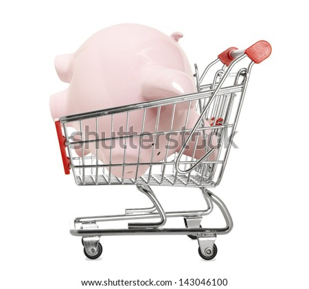Piggy bank in a shopping trolley isolated on white