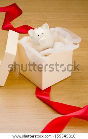 Piggy bank in gift box - stock photo