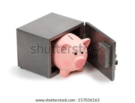 Piggy bank in safe. Bank safe is better than keeping money at home concept.