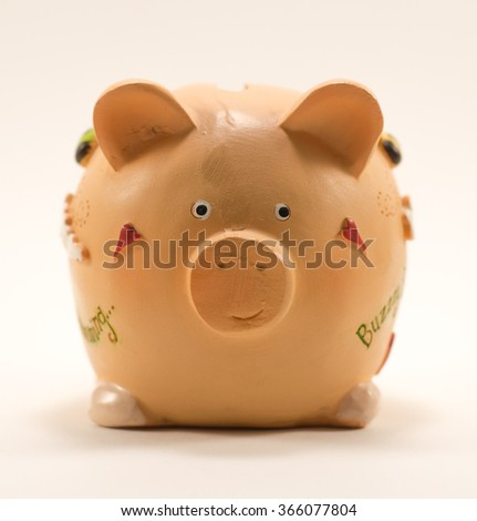 Piggy Bank isolated on white with soft natural shadow, three quarters to camera, front to back focus. - stock photo