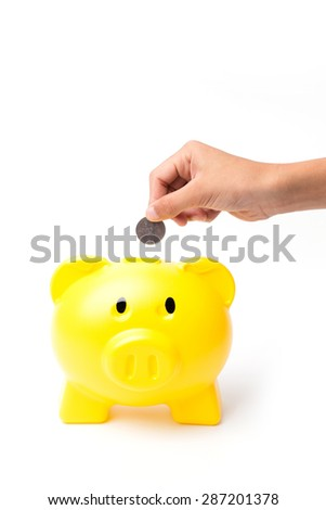 Piggy bank looking up for the coin isolated on white
