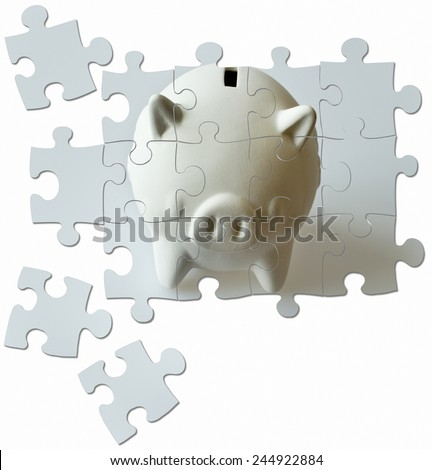 piggy bank made of puzzle - economy and finance - stock photo