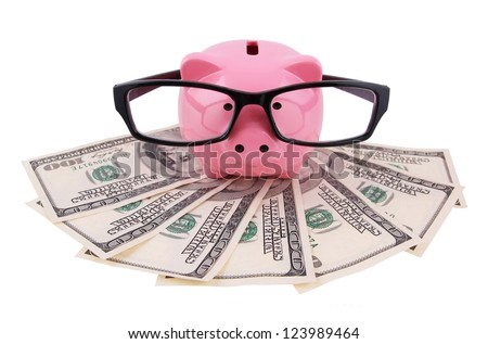Piggy bank money box with money and glasses isolated on a white studio background - stock photo